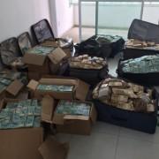 Quem vai comprar um carro, uma casa, não carrega mala de dinheiro, diz o presidente do Coaf, Antônio Gustavo Rodrigues, que defende a proibição de pagamentos em dinheiro acima de R$ 30 mil. Divulgação/Polícia Federal